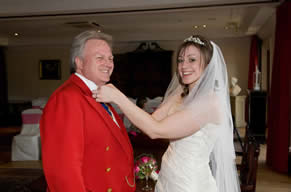 Wedding Toastmaster in Essex Richard Palmer having his Bowtie adjusted by the Bride