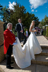 Essex Wedding Toastmaster with bride and bridegroom, holding Lucy's Wedding Dress