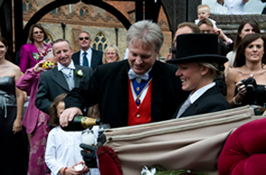 Essex Toastmaster pouring champagne for the bride and bridegroom outside St. Mary's Church, Great Baddow
