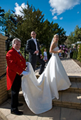 Essex toastmaster Richard Palmer assisting the bride with her wedding dress