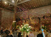 Confetti cannnon let off at wedding reception at Gaynes Park, Essex