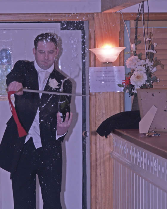 Sabrage the Champagne for Groom with help from the Essex Wedding Toastmaster