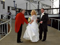 Essex wedding toastmaster Richard Palmer with the bride and groom as they arrive for their wedding reception